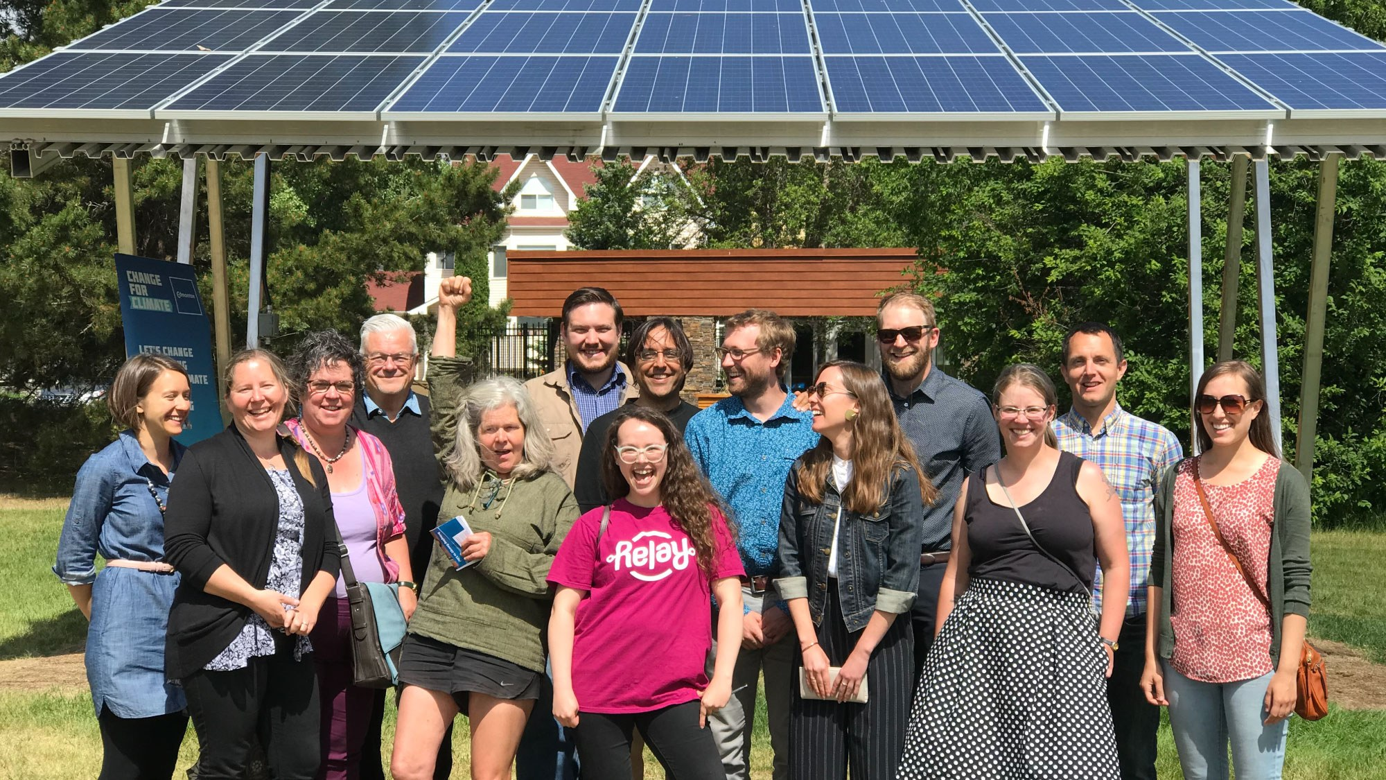 past recipients of an EcoCity Edmonton grant standing in front of a solar gazebo