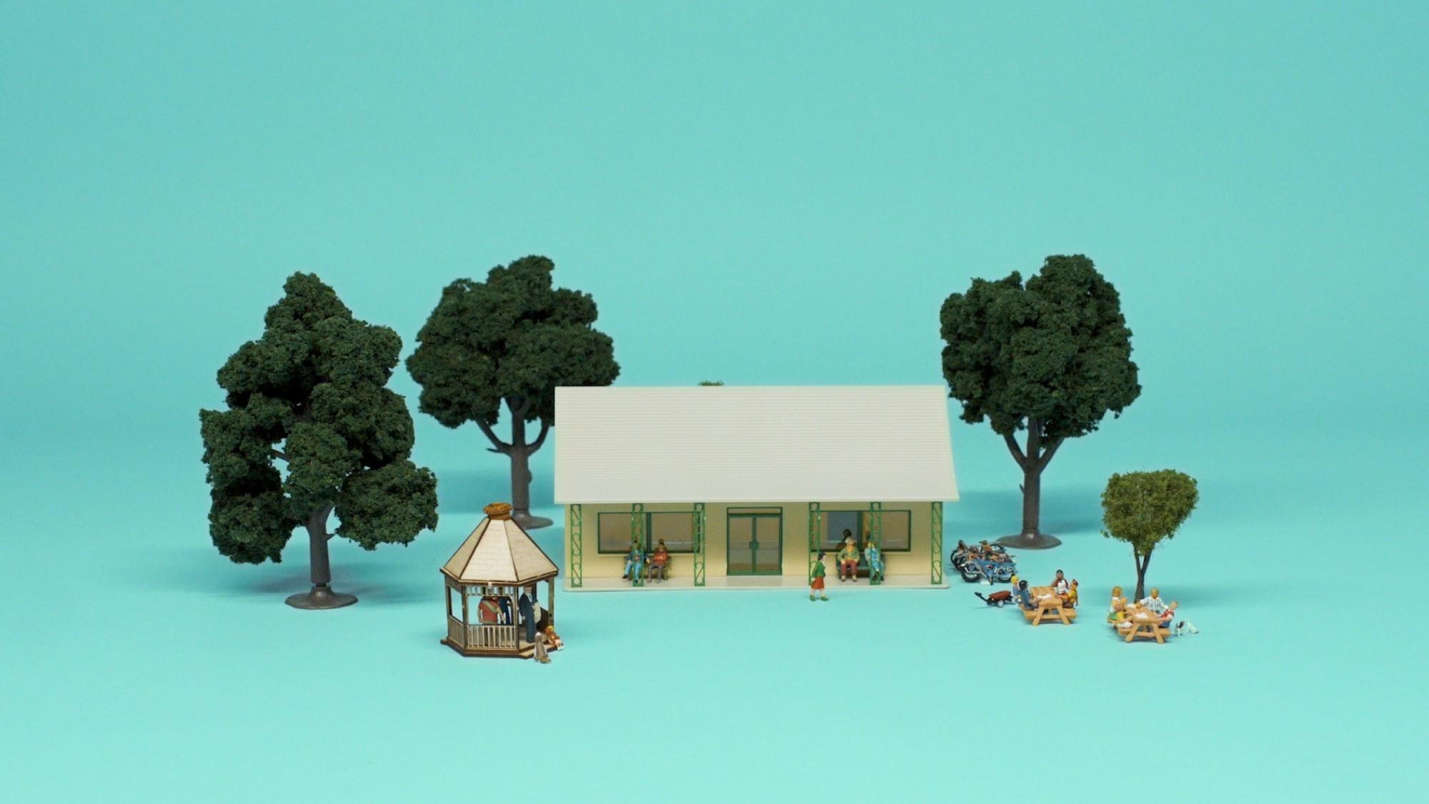 mini figurines of people at a community hall